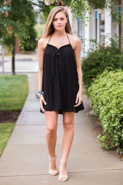 Look with black mini halter dress and heels