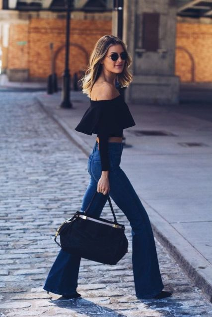 Look with black ruffle top and flare jeans
