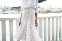Look with classic white shirt and white lace trumpet skirt