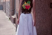 Look with fruit print t-shirt and white skirt