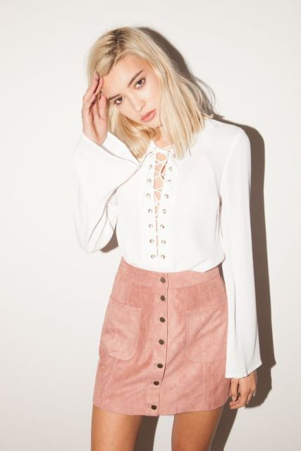 Look with gentle pink button front skirt and lace up blouse