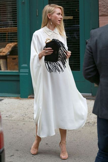 Look with loose shirtdress and fringe clutch