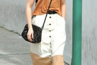 Look with midi button front skirt and crossbody bag