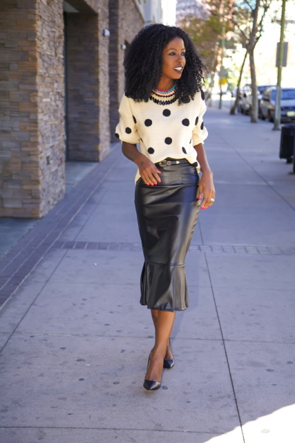 Look with polka dot shirt and leather trumpet skirt