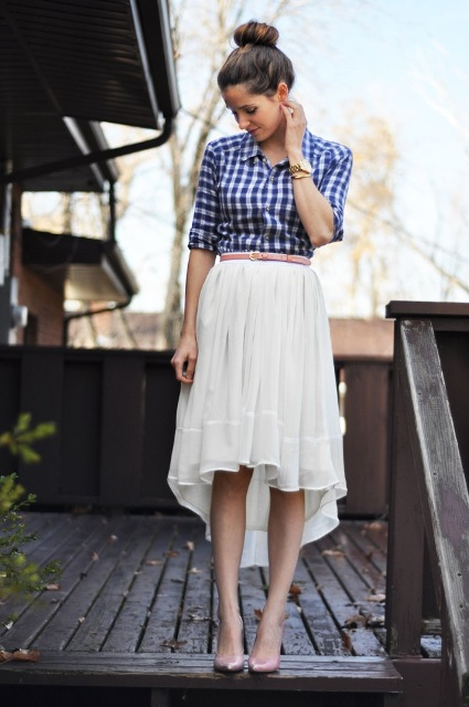 Look with white belted high low skirt and button-down shirt