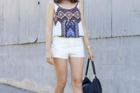 Look with white shorts and printed tank top