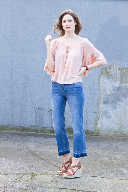 Loose blouse and cropped flared jeans