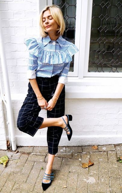 Outfit with ruffle shirt and printed trousers