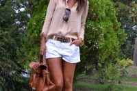 Pastel color blouse and white shorts with belt