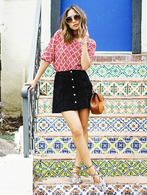 Printed loose shirt and black button front skirt