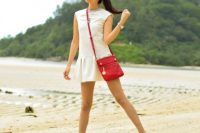 Sporty look with white drop waist dress, red bag and green sneakers