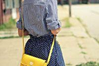 Stylish look with polka dot skirt, plaid shirt and eye-catching bag