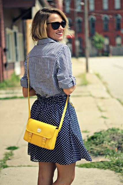 Stylish look with polka dot skirt, plaid shirt and eye-catching bag
