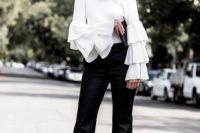 White blouse with ruffle sleeves and black pants