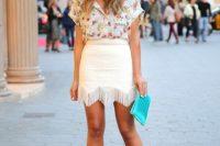 White fringe skirt and floral blouse