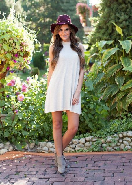 White halter dress with wide brim hat
