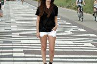 White mini shorts and black t-shirt