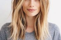 light brown to blond shoulder-length hair