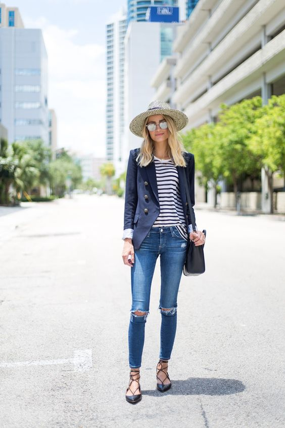 a striped tee, blue ripped jeans, a navy blazer and lace up flats