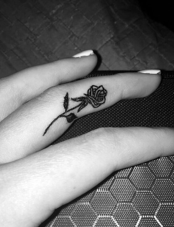 black finger rose tattoo