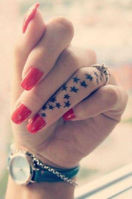 black stars on a finger