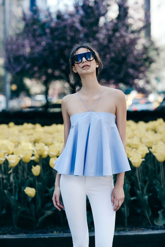 white jeans and a powder blue top
