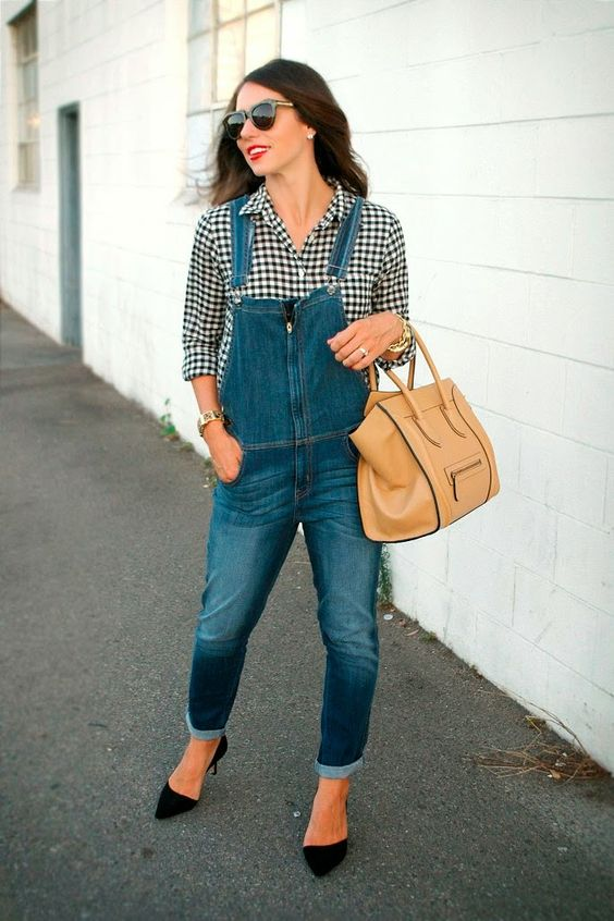an overall, a gingham short, black heels and a tan bag