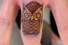 03 colorful owl hand tattoo