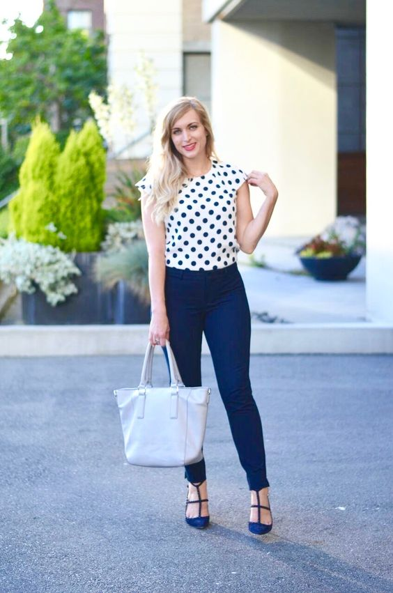 blue jeans, a polka dot top and blue heels
