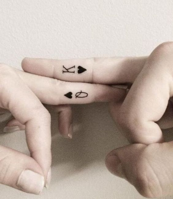couple finger tattos