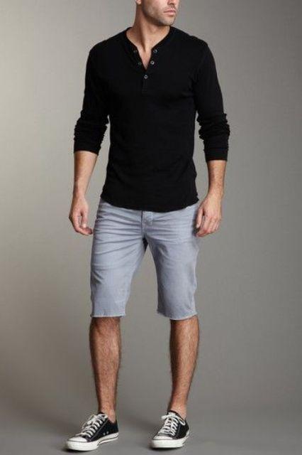 denim shorts, a black shirt and black Converse