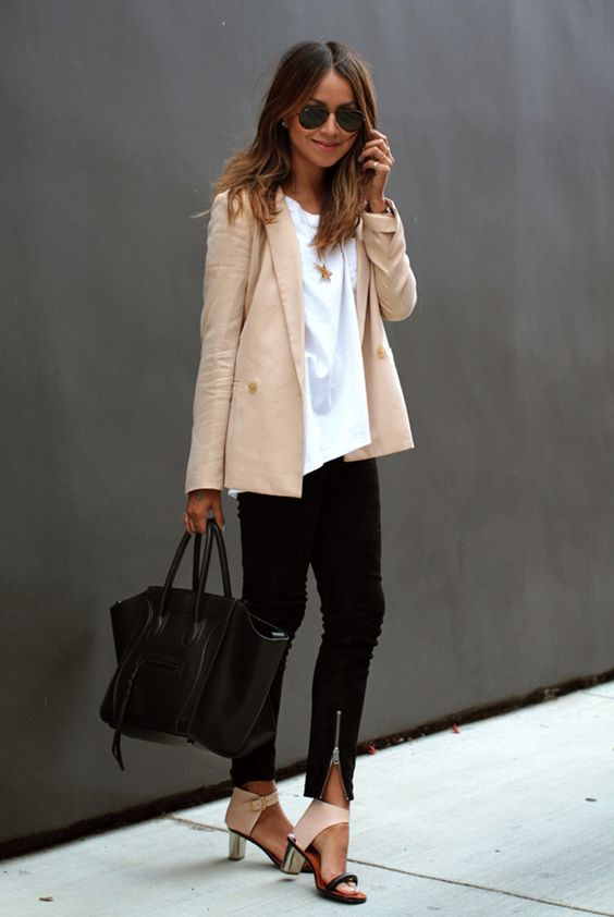 black jeans, a white tee, a blush jacket and shoes, a black bag