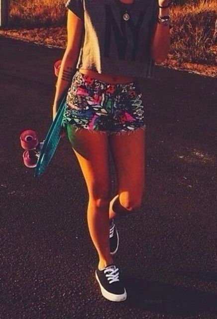bold printed shorts, a crop top and black Vans
