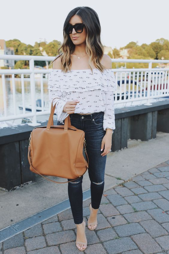 Dark jeans, an off the shoulder blouse and nude heels.