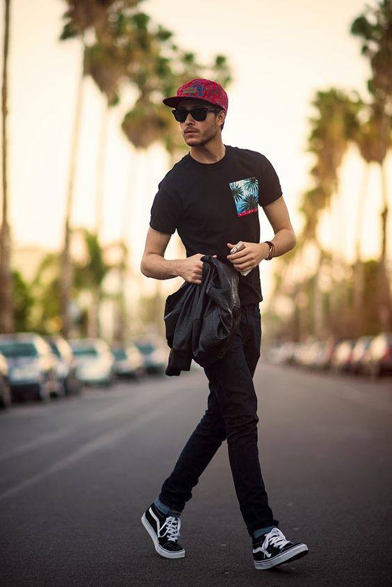 black jeans, a black printed tee and black vans for a sporty look