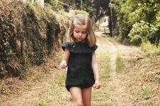 07 black ruffled sunsuit and black sneakers
