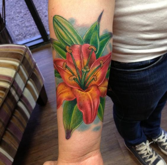 bright orange lily on the forearm
