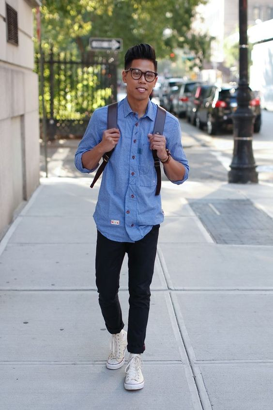 black jeans, a chambray shirt and white Converse