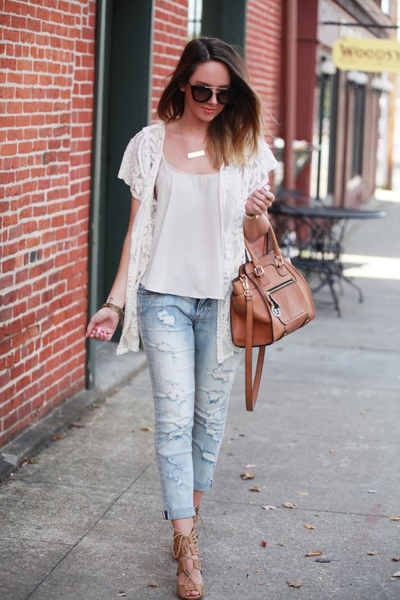 distressed jeans, a white tee, a lace vest and tan lace up heels