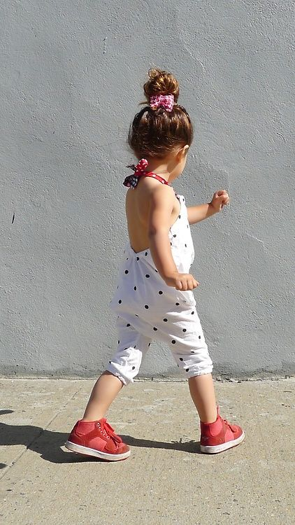 dotted sunsuit with red sneakers