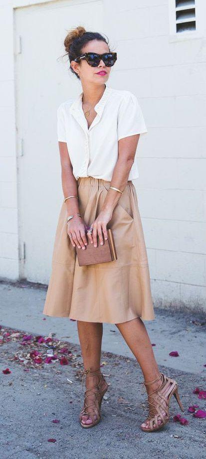 tan midi skirt, a white blouse and tan heels