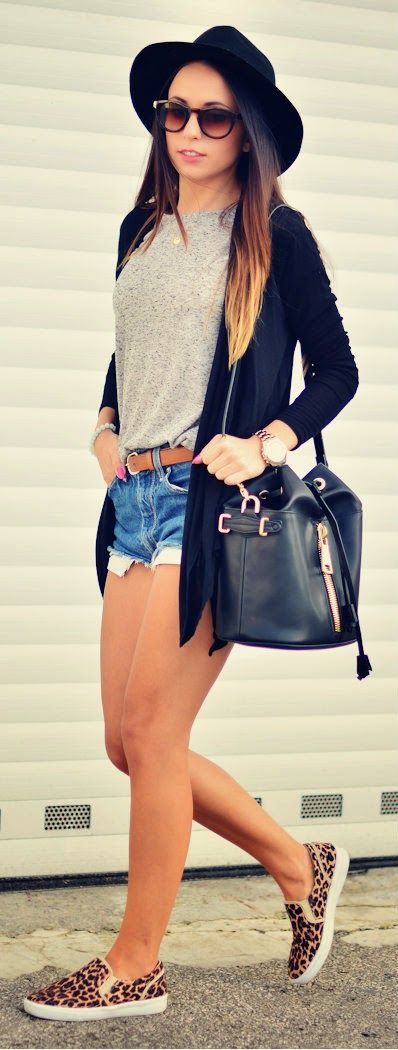 denim shorts, a grey tee, animal-printed shoes and a black cardigan