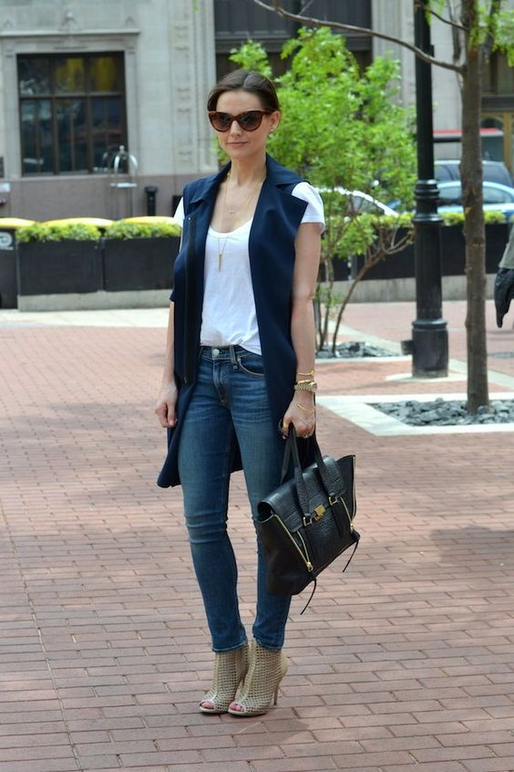 jeans, a white tee, a black vest and grey cutout boots