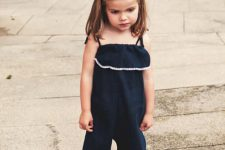 10 navy ruffled sunsuit with navy sneakers