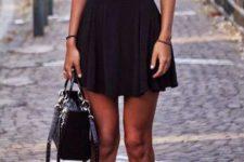 11 black skater skirt, a black top and black sandals