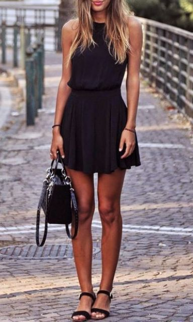 black skater skirt, a black top and black sandals