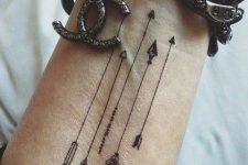 12 arrows on a wrist