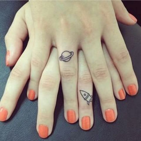 space inspired finger tattoos for best girlfriends