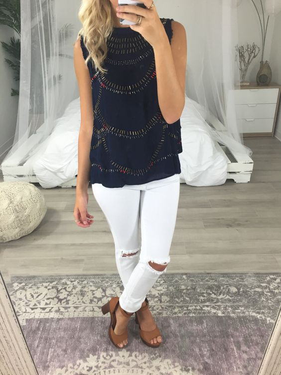13 white distressed jeans, a navy patterned top and tan shoes