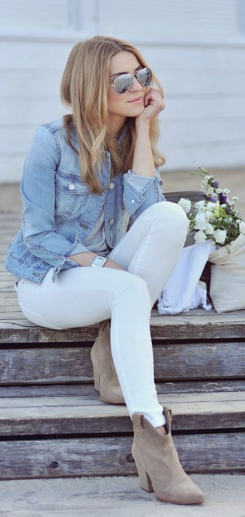 white jeans, a grey tee, a denim jacket and grey boots